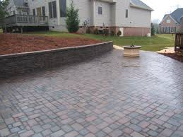 Paver Patio Designs With Fire Pit Grey Stone Patio With Round Fire Pit And Stacked Stone Bench Near