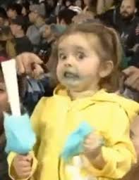 Yellow Raincoat Girl Meme - little girl steals show at seattle mariners baseball game as she