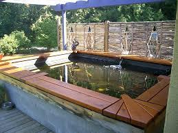 koi pond bench inside raised garden pond design ideas