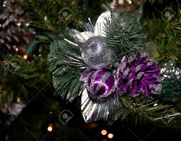 up of ornaments and lights on the tree purple