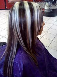 white hair with black lowlights black hair with blonde chunks christina aguilera black white