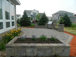 exterior top notch picture of grey brick backyard paver and pine