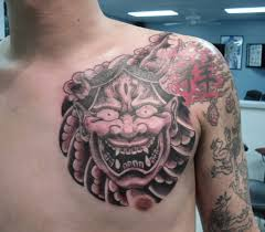 63 mask tattoos on chest