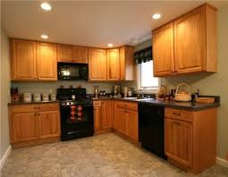 kitchens with black appliances and oak cabinets delightful brown kitchen cabinets white appliances 1