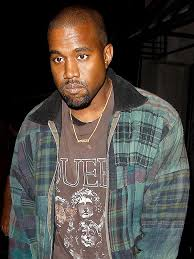 man name necklace images One proud pops kanye west wears 39 saint 39 necklace to l a lounge jpg