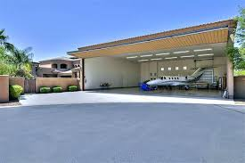 my little red plane in garage door muralsaircraft hangar style
