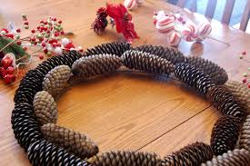 family ever after christmas pinecone wreath