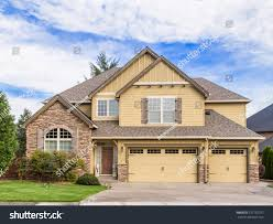 three car garage beautiful newly built luxury home exterior stock photo 577752757