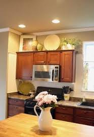 Decorateabovekitchencabinets Home Decor Decorating Above The - Decor for top of kitchen cabinets