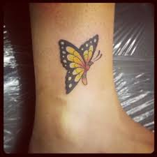and black butterfly tattoos yellow black ink butterfly