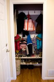 Coat Closet by Remodelaholic Reinterpreting The Hall Closet To A Mini Mudroom