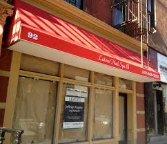 dueling nail salons on 7th avenue which will open first