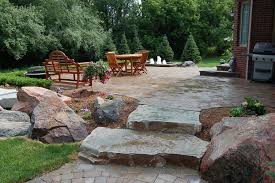 brick paver patio natural stone steps water fountain