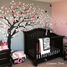 baby nursery decor wooden crib accompanied by colorful tree baby