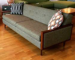 mid century modern designed sofa with wood arms custom made in usa