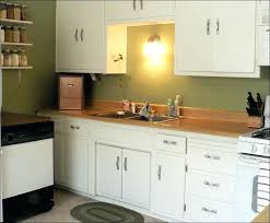 painting pressboard kitchen cabinets particle board kitchen cabinets s painting laminated particle