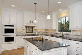 best countertops for white kitchen cabinets white kitchen cabinets with granite countertops logischo com