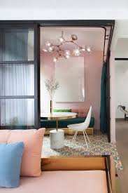 adaptable apartment revamp embraces both pastels and dazzling