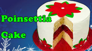 poinsettia christmas cake with icing sheet flower decorations from