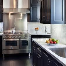 black cabinets white countertops black countertops design ideas