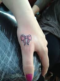 small red bow on hand tattoo girlstattoos cutetattoos