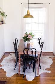 round rug for under kitchen table cowhide rugs under the dining table there s always a rug it could