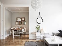 living room wall mirrors large ideas for decor loversiq decordots living room dining round mirror and stacks of magazines dining room table cheap
