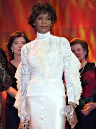 whitney houston dies her iconic style remembered