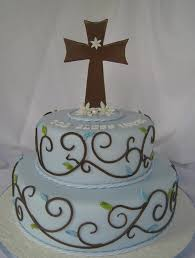 cake design with two tiers in baby blue and brown and cross cake