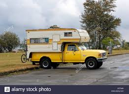Ford F250 Truck Camper - parked 1990 u0027s yellow ford f250 pickup truck with a camper in stock