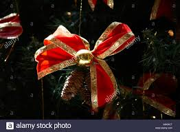 tree decorations with gold and ribbon bow fir cones