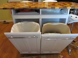 quartz countertops kitchen island with trash storage lighting