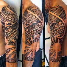 polynesian tribal half sleeve tattoo with negative space sun