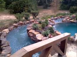 diy backyard natural lazy river with stone liner and small garden