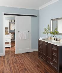 mixing wood and painted cabinets bathroom contemporary with blue walls