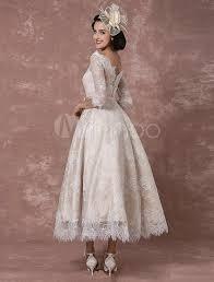 robe de mariée en dentelle bateau vintage champagne demi manches a