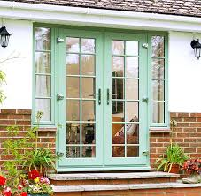 full view of everest upvc french doors in a chartwell green