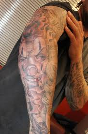 full sleeve joker n clown tattoo design for men real photo