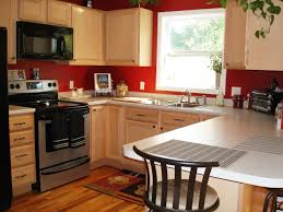 brown kitchen cabinets with black countertop shining home design