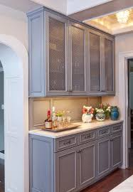 gray butler pantry cabinets with metal mesh doors transitional