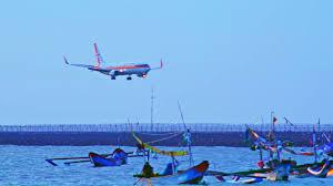 airasia ngurah rai airport denpasar indonesia apr 4 2016 aircraft descending along runway
