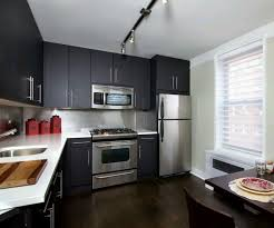 modern white kitchen cabinets black iron oven stone equipment