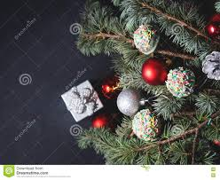 blue spruce tree branches with christmas baubles stock photo
