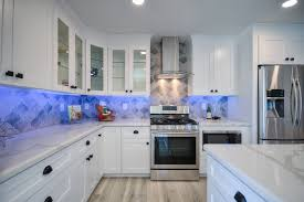 pictures of white kitchen cabinets with black stainless appliances free quote modern design cabinetry llc