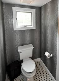 1 2 bathroom with toilet centered under window and panasonic