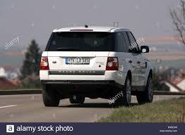 land rover hse white range rover sport tdv8 hse model year 2005 white driving stock
