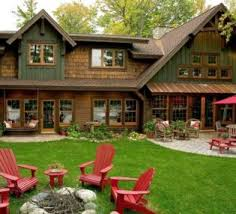 yellow house exterior color schemes with brown roof and wood deck