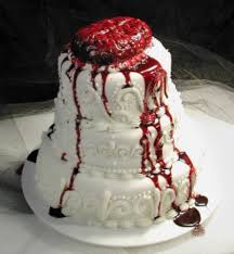 looking halloween wedding cake with bleeding brain cake topper jpg