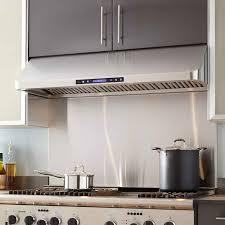 kitchen recirculating vent hood with modern stove also tile back