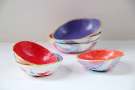 use nail varnish and air dry clay to make these marbled bowls